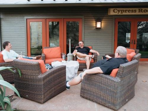 friends sitting on outdoor patio area